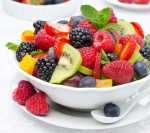 2 fruits and a glass of berries
