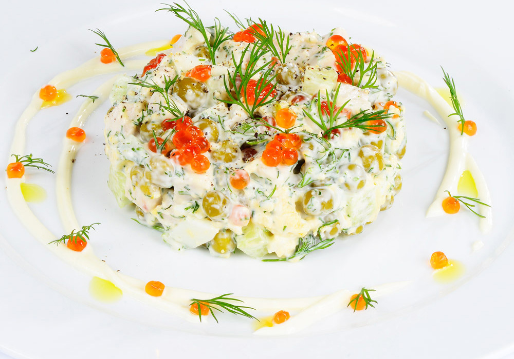 Salad with red caviar and chicken